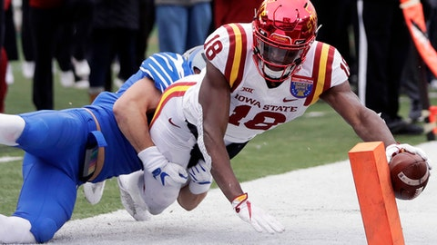 Iowa State wide receiver Hakeem Butler (18) reaches for the goal line but is knocked out of bounds at the 3-yard line by Memphis defensive back Austin Hall in the second half of the Liberty Bowl NCAA college football game Saturday, Dec. 30, 2017, in Memphis, Tenn. (AP Photo/Mark Humphrey)