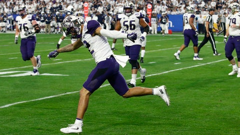 Washington wide receiver Aaron Fuller (12) celebrates his touchdown against Penn State during the second half of the Fiesta Bowl NCAA college football game Saturday, Dec. 30, 2017, in Glendale, Ariz. (AP Photo/Ross D. Franklin)