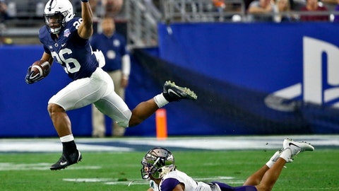 Penn State running back Saquon Barkley (26) leaps over Washington defensive back Myles Bryant (5) during the second half of the Fiesta Bowl NCAA college football game Saturday, Dec. 30, 2017, in Glendale, Ariz. (AP Photo/Ross D. Franklin)