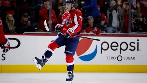 Washington Capitals defenseman John Carlson celebrates his goal in the second period of an NHL hockey game against the New Jersey Devils, Saturday, Dec. 30, 2017, in Washington. (AP Photo/Alex Brandon)