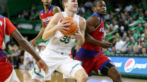 Marshall's Jon Elmore (33) drives to the basket against Louisiana Tech's Derric Jean (1) during an NCAA college basketball game Saturday, Dec. 30, 2017, in Huntington, W.Va. (Sholten Singer/The Herald-Dispatch via AP)
