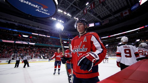 Washington Capitals center Nicklas Backstrom, from Sweden, comes to bench to celebrate his empty net goal in the third period of an NHL hockey game against the New Jersey Devils, Saturday, Dec. 30, 2017, in Washington. The Capitals won 5-2. (AP Photo/Alex Brandon)