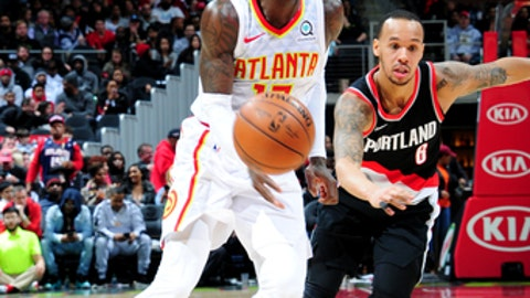 ATLANTA, GA - DECEMBER 30: Dennis Schroder #17 of the Atlanta Hawks handles the ball during the game against the Portland Trail Blazers on December 30, 2017 at Philips Arena in Atlanta, Georgia.  NOTE TO USER: User expressly acknowledges and agrees that, by downloading and/or using this Photograph, user is consenting to the terms and conditions of the Getty Images License Agreement. Mandatory Copyright Notice: Copyright 2017 NBAE (Photo by Scott Cunningham/NBAE via Getty Images)