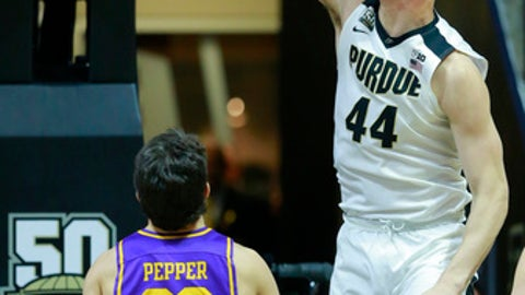 Purdue center Isaac Haas (44) dunks in front of Lipscomb forward Eli Pepper in the second half of an NCAA college basketball game, Saturday, Dec. 30, 2017, in West Lafayette, Ind. (AP Photo/R Brent Smith)