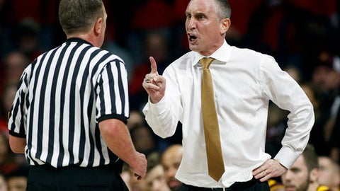 Arizona State coach Bobby Hurley, right, makes his point to official Dave Hall during the second half of the team's NCAA college basketball game against Arizona, Saturday, Dec. 30, 2017, in Tucson, Ariz. Arizona defeated Arizona State 84-78. (AP Photo/Ralph Freso)