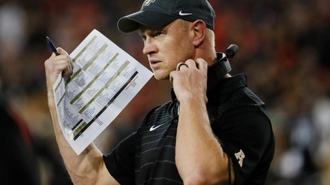 FILE - In this Oct. 7, 2017, file photo, UCF head coach Scott Frost works the sidelines in the first half of an NCAA college football game against Cincinnati, in Cincinnati. No. 10 Central Florida will by playing for a perfect season and respect for the team and its conference, when it faces No. 7 Auburn in the Peach Bowl on Monday, Jan 1, 2018.  (AP Photo/John Minchillo, File)