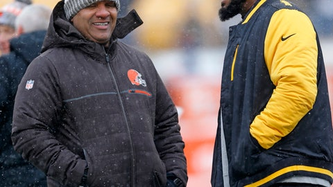 Cleveland Browns head coach Hue Jackson, left, and Pittsburgh Steelers head coach Mike Tomlin visit on the field during warmups before an NFL football game in Pittsburgh, Sunday, Dec. 31, 2017. (AP Photo/Keith Srakocic)