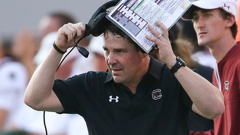 FILE - In this Saturday, Nov. 4, 2017, file photo, South Carolina head coach Will Muschamp coaches his team against Georgia during the second half of an NCAA college football game in Athens, Ga. Don't try to sell Muschamp or Jim Harbaugh on the notion that New Year's Day games that are not part of the College Football Playoff are irrelevant. The coaches for Michigan and South Carolina expect to contend for national championships moving forward, but also feel it's important to finish this season with a strong performance in the Outback Bowl. (AP Photo/John Bazemore, File)
