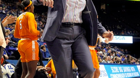 Tennessee head coach Holly Warlick leaps as Tennessee scores and draws a foul while playing against Kentucky during an NCAA college basketball game in Lexington, Ky., Sunday, Dec. 31, 2017. (AP Photo/Matt Goins)
