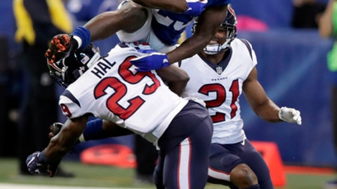 Indianapolis Colts' Frank Gore (23) is tackled by Houston Texans' Andre Hal (29) during the second half of an NFL football game, Sunday, Dec. 31, 2017, in Indianapolis. (AP Photo/Michael Conroy)