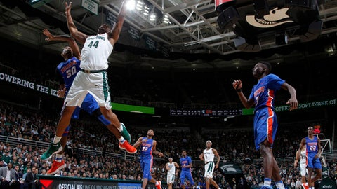 Michigan State's Nick Ward (44) gets a layup against Savannah State's Jahir Cabeza (30) as Savannah State's Zach Sellers, right, watches during the second half of an NCAA college basketball game, Sunday, Dec. 31, 2017, in East Lansing, Mich. Michigan State won 108-52. (AP Photo/Al Goldis)