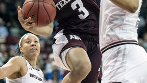 Texas A&M guard Chennedy Carter (3) attempts a shot against South Carolina forward Alexis Jennings, right, during the first half of an NCAA college basketball game, Sunday, Dec. 31, 2017, in Columbia, S.C. (AP Photo/Sean Rayford)