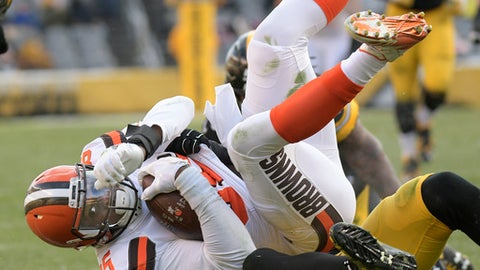Cleveland Browns tight end David Njoku (85) is tackled by Pittsburgh Steelers outside linebacker T.J. Watt (90) during the second half of an NFL football game in Pittsburgh, Sunday, Dec. 31, 2017. (AP Photo/Don Wright)