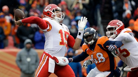 Kansas City Chiefs quarterback Patrick Mahomes, left, throws against the Denver Broncos during the first half of an NFL football game against the Denver Broncos, Sunday, Dec. 31, 2017, in Denver. (AP Photo/Joe Mahoney )