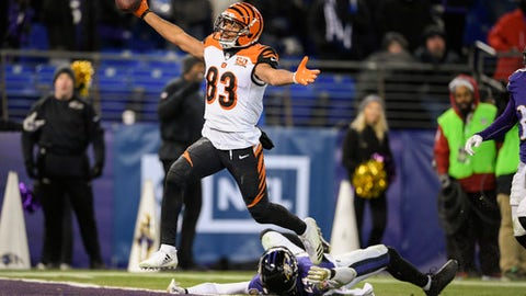 Cincinnati Bengals wide receiver Tyler Boyd (83) reacts as he scores the winning touchdown as Baltimore Ravens cornerback Brandon Carr (24) lies on the ground during the second half of an NFL football game in Baltimore, Sunday, Dec 31, 2017. The Bengals defeated the Ravens 31-27. (AP Photo/Nick Wass)