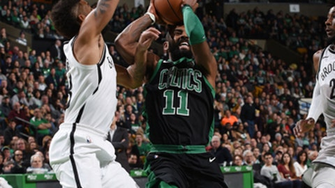 BOSTON, MA - DECEMBER 31:  Kyrie Irving #11 of the Boston Celtics handles the ball against the Brooklyn Nets on December 31, 2017 at TD Garden in Boston, Massachusetts.  NOTE TO USER: User expressly acknowledges and agrees that, by downloading and or using this photograph, User is consenting to the terms and conditions of the Getty Images License Agreement. Mandatory Copyright Notice: Copyright 2017 NBAE  (Photo by Steve Babineau/NBAE via Getty Images)