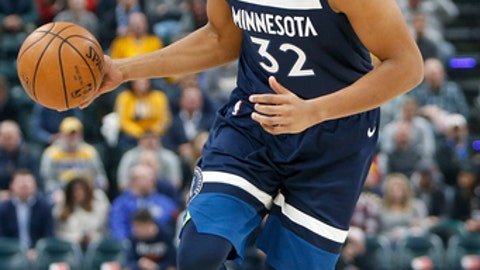INDIANAPOLIS, IN - DECEMBER 31:  Karl-Anthony Towns #32 of the Minnesota Timberwolves dribbles the ball against the Indiana Pacers during the first half at Bankers Life Fieldhouse on December 31, 2017 in Indianapolis, Indiana. NOTE TO USER: User expressly acknowledges and agrees that, by downloading and or using this photograph, User is consenting to the terms and conditions of the Getty Images License Agreement.  (Photo by Michael Reaves/Getty Images)
