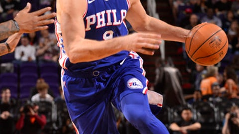 PHOENIX, AZ - DECEMBER 31: Dario Saric #9 of the Philadelphia 76ers handles the ball against the Phoenix Suns on December 31, 2017 at Talking Stick Resort Arena in Phoenix, Arizona. NOTE TO USER: User expressly acknowledges and agrees that, by downloading and or using this photograph, user is consenting to the terms and conditions of the Getty Images License Agreement. Mandatory Copyright Notice: Copyright 2017 NBAE (Photo by Barry Gossage/NBAE via Getty Images)