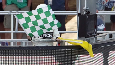 DAYTONA BEACH, FL - FEBRUARY 25:  A NASCAR XFINITY Series official waves a green and white checkered flag to end a segment during the NASCAR XFINITY Series PowerShares QQQ 300 at Daytona International Speedway on February 25, 2017 in Daytona Beach, Florida.  (Photo by Chris Graythen/Getty Images)
