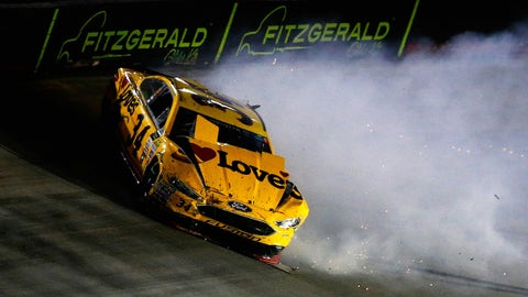 BRISTOL, TN - AUGUST 19:  Landon Cassill, driver of the #34 Love's Travel Stops Ford, spins during the Monster Energy NASCAR Cup Series Bass Pro Shops NRA Night Race at Bristol Motor Speedway on August 19, 2017 in Bristol, Tennessee.  (Photo by Sean Gardner/Getty Images)