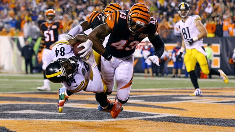 Dec 4, 2017; Cincinnati, OH, USA; Pittsburgh Steelers wide receiver Antonio Brown (84) catches the game tying touchdown against Cincinnati Bengals cornerback Dre Kirkpatrick (27) and is hit as a penalty of unnecessary roughness is called on free safety George Iloka (right) in the second half at Paul Brown Stadium. Mandatory Credit: Aaron Doster-USA TODAY Sports