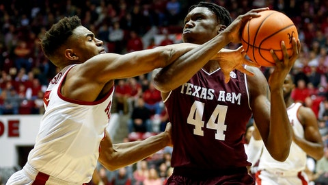 Dec 30, 2017; Tuscaloosa, AL, USA; Texas A&M Aggies forward Robert Williams (44) is fouled by Alabama Crimson Tide guard Avery Johnson Jr. (5) while shooting the ball during the first half at Coleman Coliseum. Mandatory Credit: Butch Dill-USA TODAY Sports