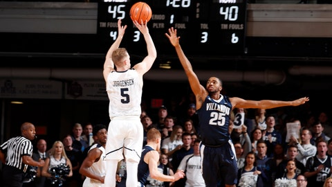 Dec 30, 2017; Indianapolis, IN, USA; Butler Bulldogs guard Paul Jorgensen (5) takes a three point shot against Villanova Wildcats forward Mikal Bridges (25) during the first half at Hinkle Fieldhouse. Mandatory Credit: Brian Spurlock-USA TODAY Sports