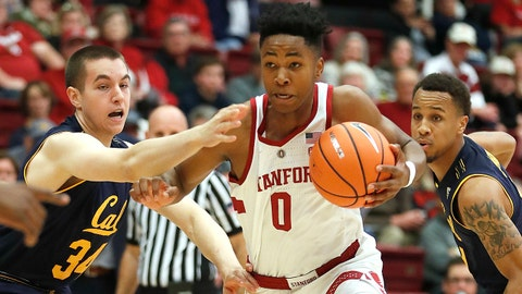 Stanford forward Kezie Okpala (0) drives to the basket past California forward Grant Anticevich (34) during the first half of an NCAA college basketball game Saturday, Dec. 30, 2017, in Stanford, Calif. (AP Photo/Tony Avelar)