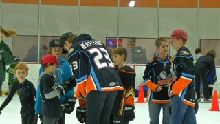 San Diego Gulls players skate with fans at the re-opening of 'THE RINKS - Poway ICE'