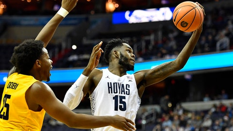 Dec 9, 2017; Washington, DC, USA; Georgetown Hoyas center Jessie Govan (15) catches a pass as North Carolina A&T Aggies forward Femi Olujobi (25) looks on during the first half at Capital One Arena. Mandatory Credit: Brad Mills-USA TODAY Sports