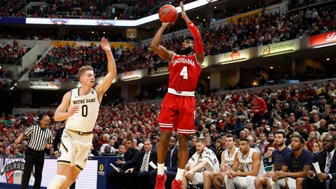 Dec 16, 2017; Indianapolis, IN, USA; Indiana Hoosiers guard Robert Johnson (4) takes a shot against Notre Dame Fighting Irish guard Rex Pflueger (0) during the first half at Bankers Life Fieldhouse. Mandatory Credit: Brian Spurlock-USA TODAY Sports