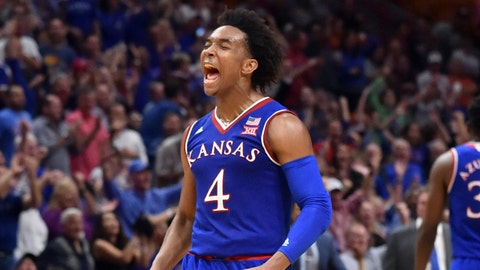 Dec 2, 2017; Miami, FL, USA; Kansas Jayhawks guard Devonte' Graham (4) celebrates against the Syracuse Orange during the second half at American Airlines Arena. Mandatory Credit: Steve Mitchell-USA TODAY Sports