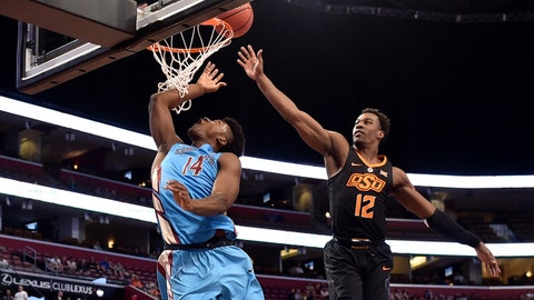 Dec 16, 2017; Sunrise, FL, USA; Florida State Seminoles guard Terance Mann (14) drives to the basket as Oklahoma State Cowboys forward Cameron McGriff (12) defends during the first half at BB&T Center. Mandatory Credit: Steve Mitchell-USA TODAY Sports