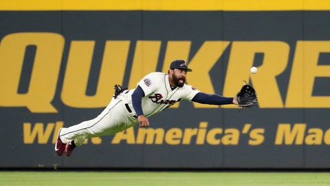 Sep 9, 2017; Atlanta, GA, USA; Atlanta Braves left fielder Matt Kemp (27) makes a diving catch to get out Miami Marlins left fielder Marcell Ozuna (not pictured) in the seventh inning at SunTrust Park. Mandatory Credit: Jason Getz-USA TODAY Sports