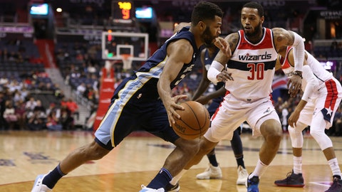 Dec 13, 2017; Washington, DC, USA; Memphis Grizzlies guard Andrew Harrison (5) drives to the basket as Washington Wizards forward Mike Scott (30) defends in the first quarter at Capital One Arena. Mandatory Credit: Geoff Burke-USA TODAY Sports