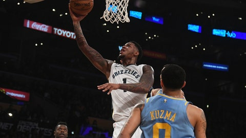 Dec 27, 2017; Los Angeles, CA, USA; Memphis Grizzlies forward Jarell Martin (1) shoots the ball past Los Angeles Lakers forward Kyle Kuzma (0) during the first half at Staples Center. Mandatory Credit: Richard Mackson-USA TODAY Sports