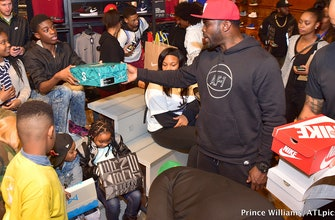 'Tis the season: Falcons great Michael Vick and Big Boi gave kids the gift of shoes