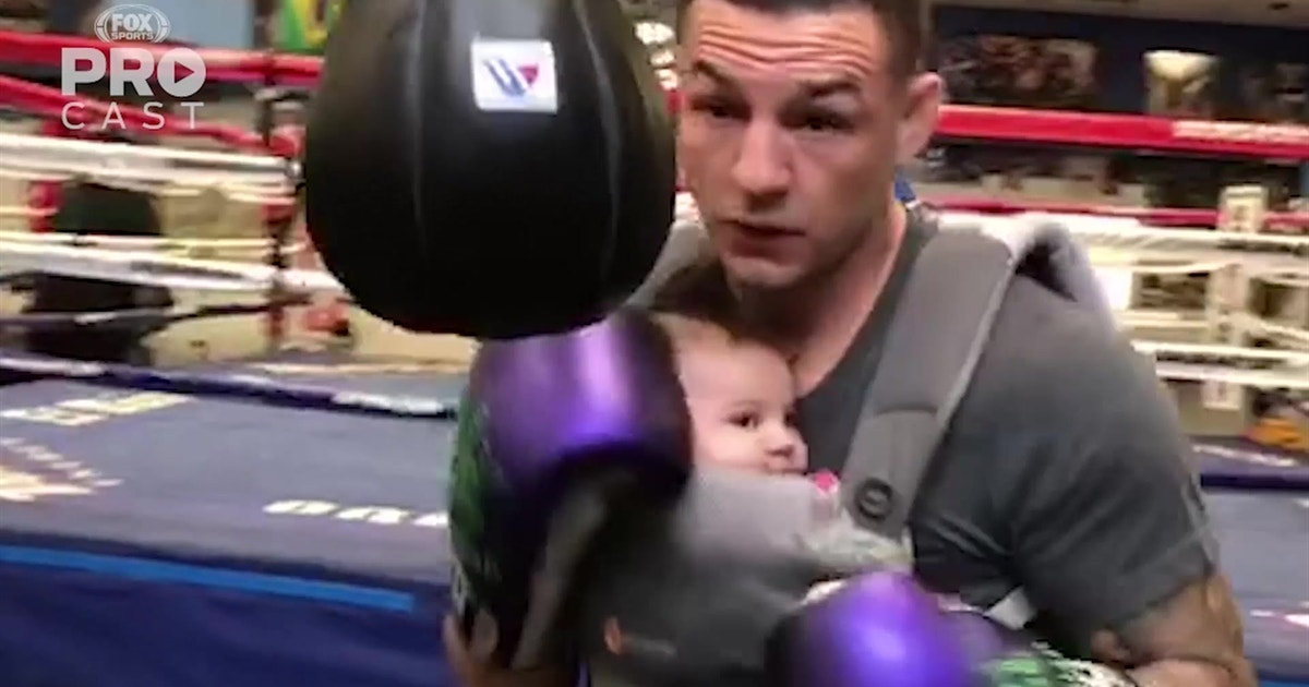 Cub Swanson gets in a workout with his infant strapped to his chest