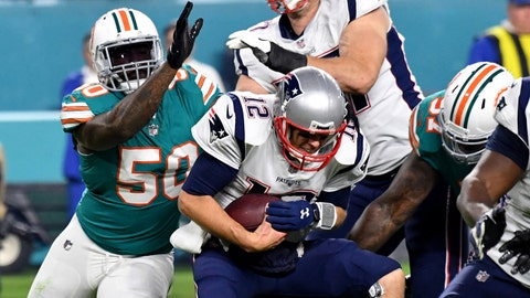 Dec 11, 2017; Miami Gardens, FL, USA; New England Patriots quarterback Tom Brady (12) is sacked by Miami Dolphins defensive end Andre Branch (50) during the second half at Hard Rock Stadium. Mandatory Credit: Steve Mitchell-USA TODAY Sports