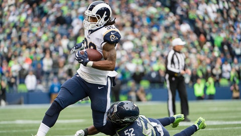 Dec 17, 2017; Seattle, WA, USA; Los Angeles Rams running back Todd Gurley (30) picks up a first down during the first half as he is tackled by Seattle Seahawks outside linebacker Terence Garvin (52) at CenturyLink Field. Mandatory Credit: Troy Wayrynen-USA TODAY Sports