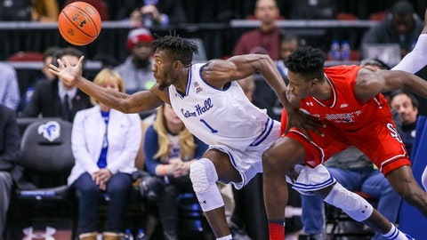 Dec 31, 2017; Newark, NJ, USA; Seton Hall Pirates forward Michael Nzei (1) reaches for the ball in front of St. John's Red Storm guard Bashir Ahmed (1) during the first half at Prudential Center. Mandatory Credit: Vincent Carchietta-USA TODAY Sports