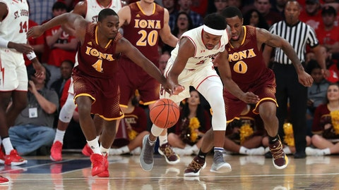 Dec 17, 2017; New York NY, USA; St. John's Red Storm guard Shamorie Ponds (2) and Iona Gaels guard Schadrac Casimir (4) chase a loose ball during the first half at Madison Square Garden. Mandatory Credit: Anthony Gruppuso-USA TODAY Sports