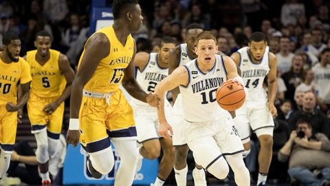 Dec 10, 2017; Philadelphia, PA, USA; Villanova Wildcats guard Donte DiVincenzo (10) dribbles up court against La Salle Explorers guard Saul Phiri (13) during the first half at Wells Fargo Center. Mandatory Credit: Bill Streicher-USA TODAY Sports