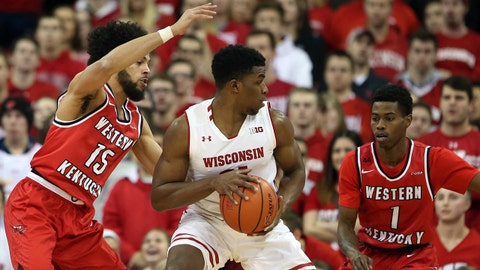 Dec 13, 2017; Madison, WI, USA; Wisconsin Badgers guard Khalil Iverson (21) works the ball against Western Kentucky Hilltoppers guard Darius Thompson (15) and guard Lamonte Bearden (1) at the Kohl Center. Mandatory Credit: Mary Langenfeld-USA TODAY Sports