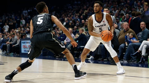 Dec 9, 2017; Cincinnati, OH, USA; Xavier Musketeers guard Trevon Bluiett (5) looks to shoot during the second half against Colorado Buffaloes guard Deleon Brown (5) at the Cintas Center. Xavier 96-69. Mandatory Credit: Frank Victores-USA TODAY Sports