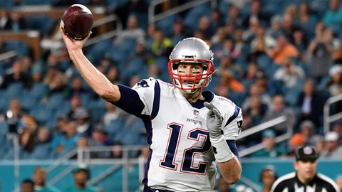 Dec 11, 2017; Miami Gardens, FL, USA; New England Patriots quarterback Tom Brady (12) throws a pass against the Miami Dolphins during the second half at Hard Rock Stadium. Mandatory Credit: Steve Mitchell-USA TODAY Sports