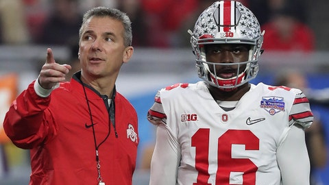 December 31, 2016; Glendale, AZ, USA;  Ohio State Buckeyes head coach Urban Meyer speaks with quarterback J.T. Barrett (16) before the game against the Clemson Tigers in the the 2016 CFP semifinal at University of Phoenix Stadium. Mandatory Credit: Matthew Emmons-USA TODAY Sports