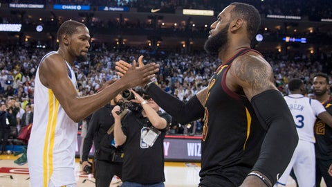 December 25, 2017; Oakland, CA, USA; Golden State Warriors forward Kevin Durant (35, left) shakes hands with Cleveland Cavaliers forward LeBron James (23, right) after the game at Oracle Arena. The Warriors defeated the Cavaliers 99-92. Mandatory Credit: Kyle Terada-USA TODAY Sports