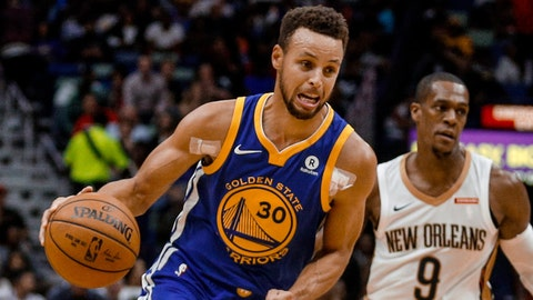 Dec 4, 2017; New Orleans, LA, USA; Golden State Warriors guard Stephen Curry (30) drives past New Orleans Pelicans center Omer Asik (3) during the second quarter at the Smoothie King Center. Mandatory Credit: Derick E. Hingle-USA TODAY Sports