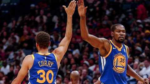 Dec 4, 2017; New Orleans, LA, USA; Golden State Warriors forward Kevin Durant (35) celebrates with guard Stephen Curry (30) during the second half against the New Orleans Pelicans at the Smoothie King Center. The Warriors defeated the Pelicans 125-115. Mandatory Credit: Derick E. Hingle-USA TODAY Sports